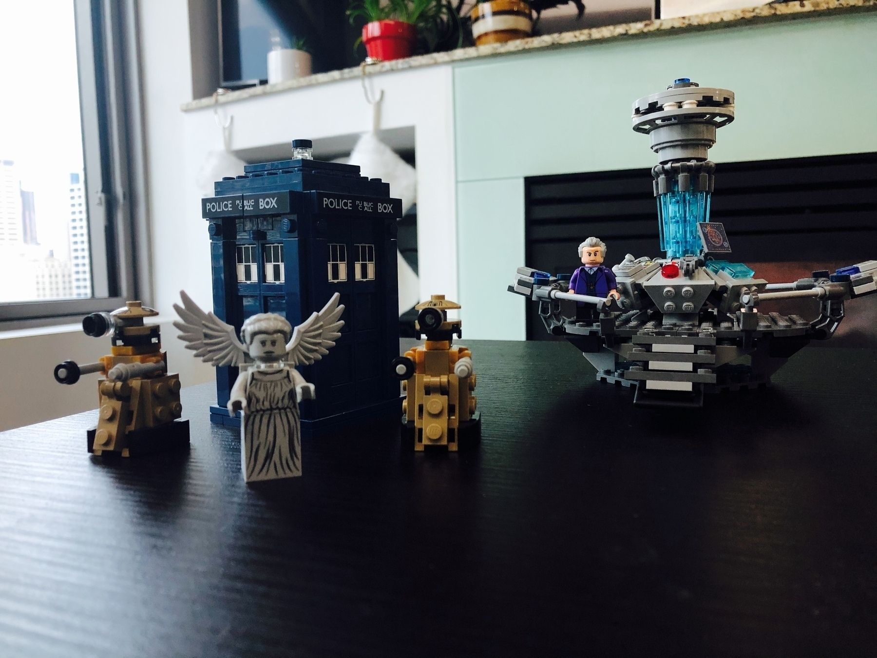 A LEGO tardis, daleks, and a weeping Angel minifig