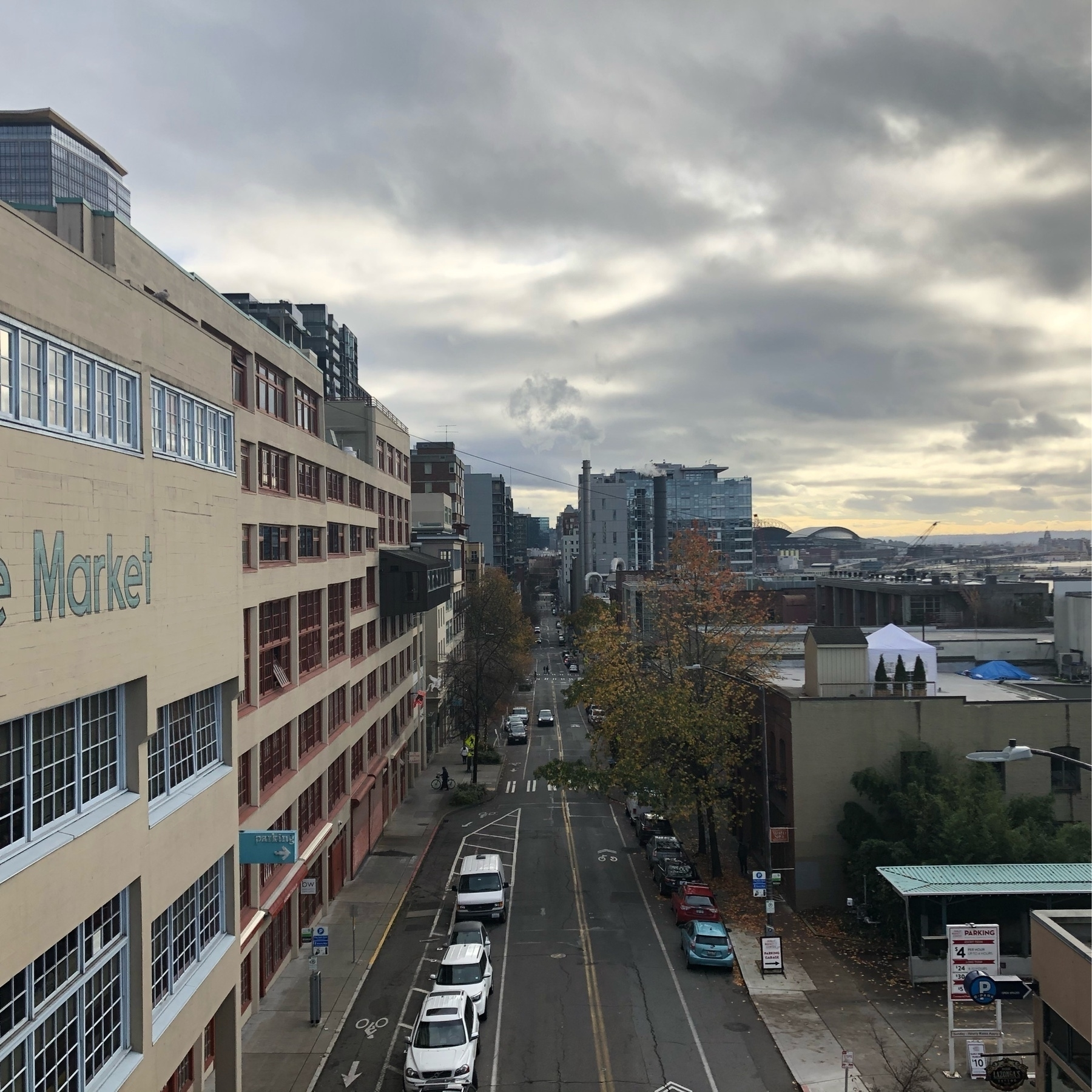 Looking down on Western Ave near pike place market beneath cloudy gray skies.