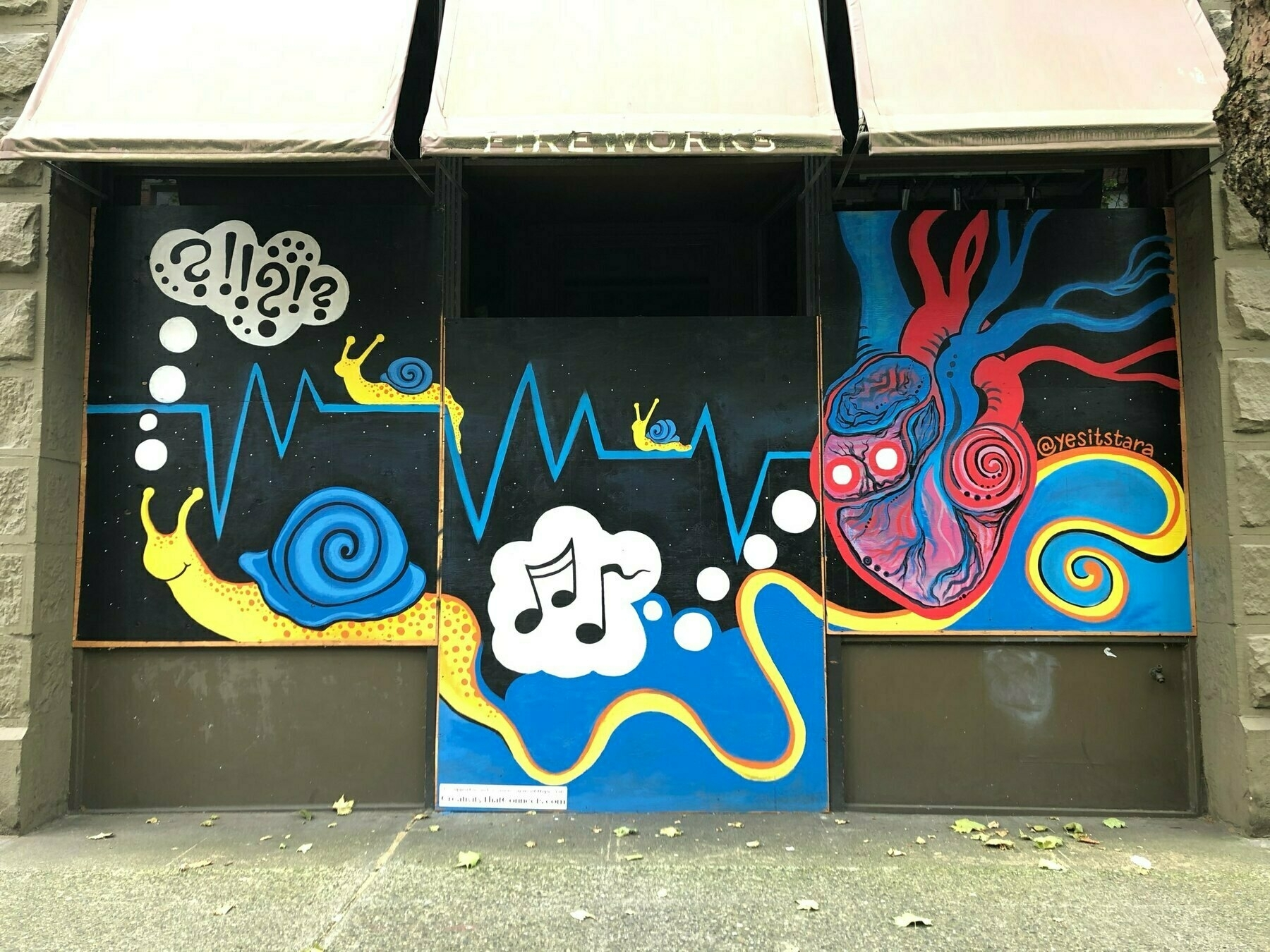a mural with a yellow snail listening to music. his tail spins out into a long ribbon and wraps around a human heart.