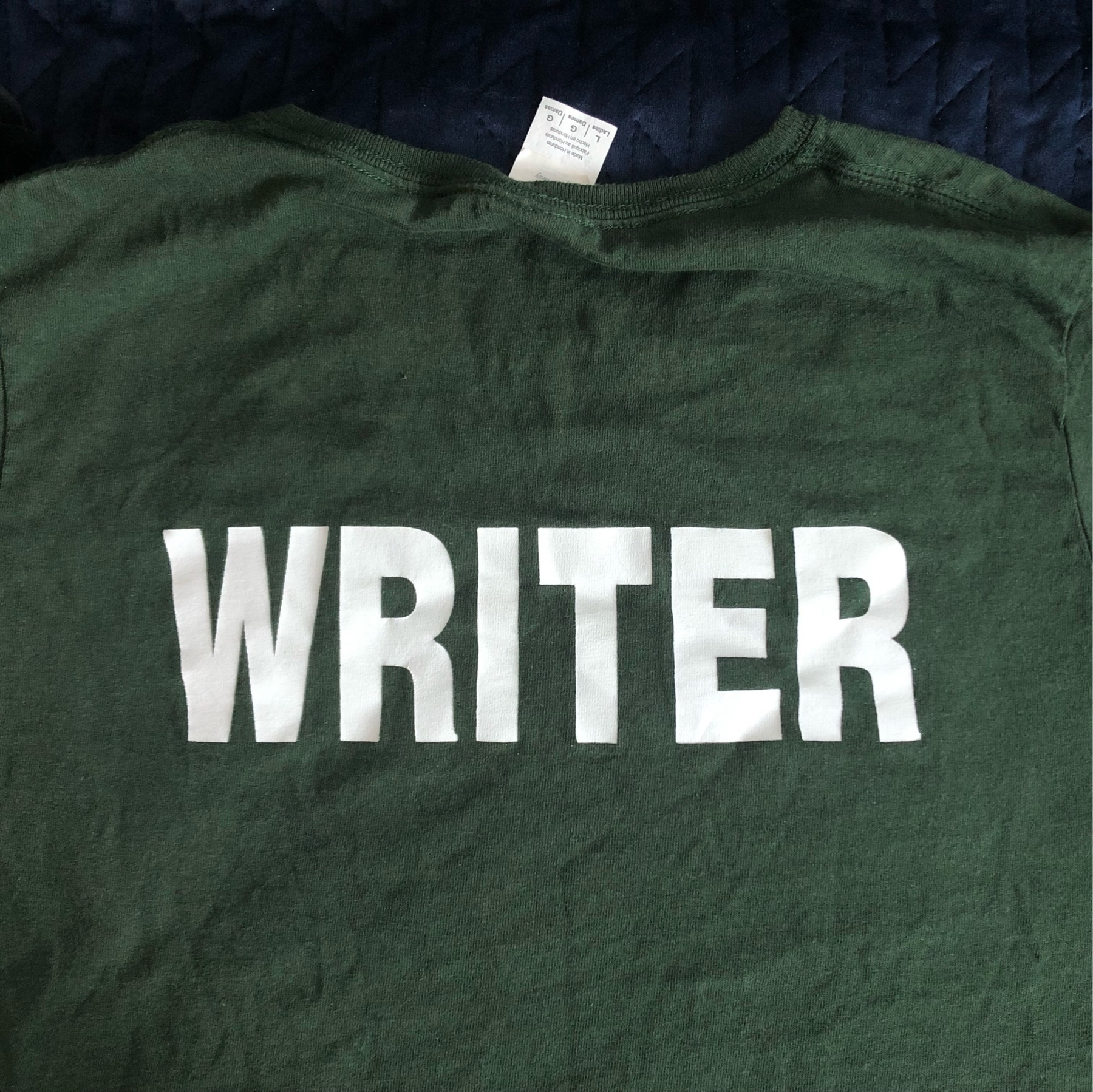 The back of a T-shirt that says WRITER in huge text.