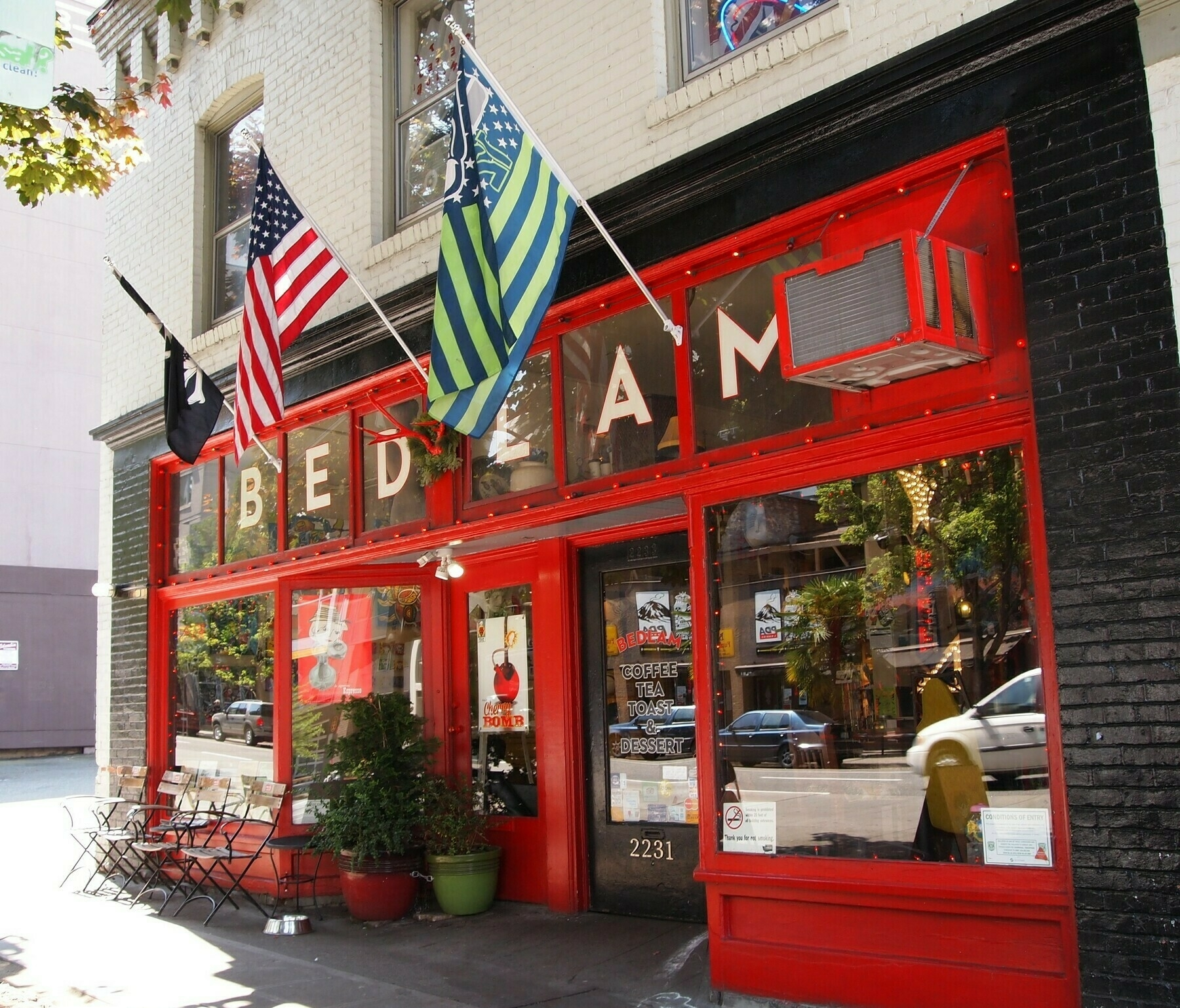 The bright red storefront of Bedlam Coffee