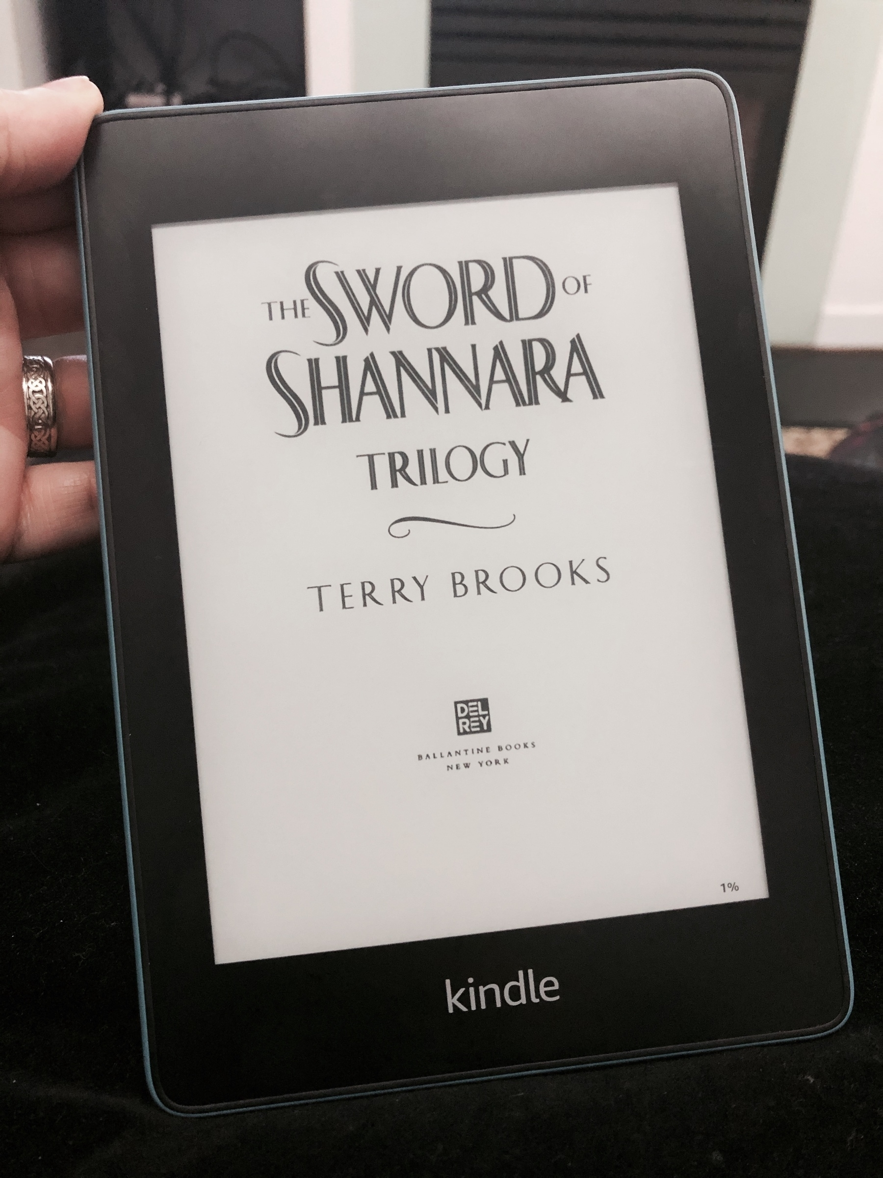A Kindle Paperwhite showing the title page of The Sword of Shannara