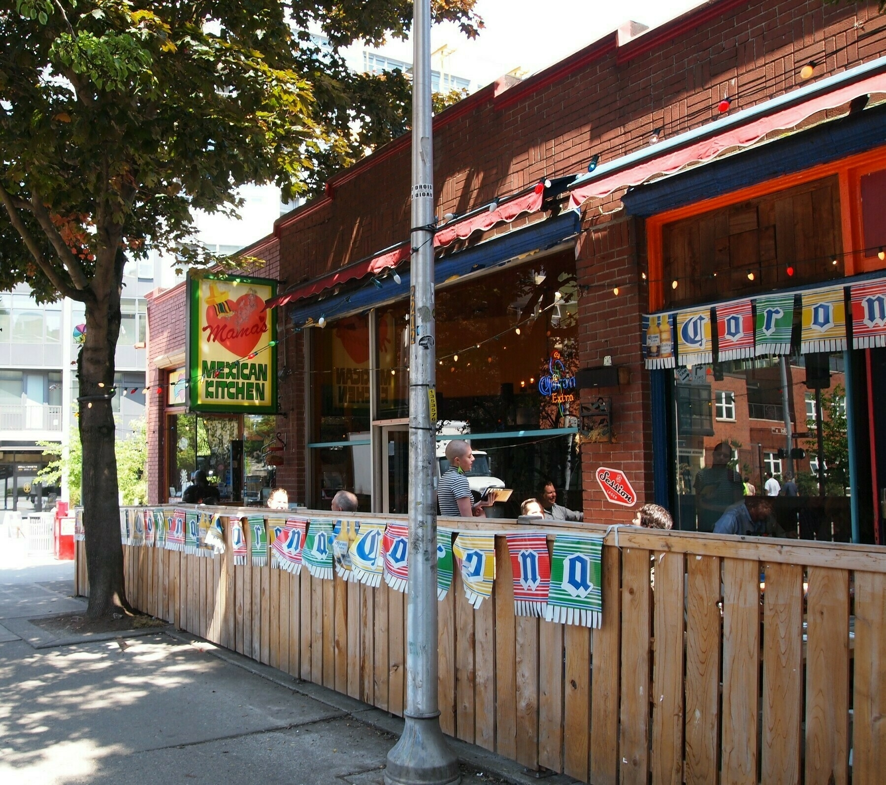 A pine fence surrounds outdoor seating at Mama's Mexican Kitchen