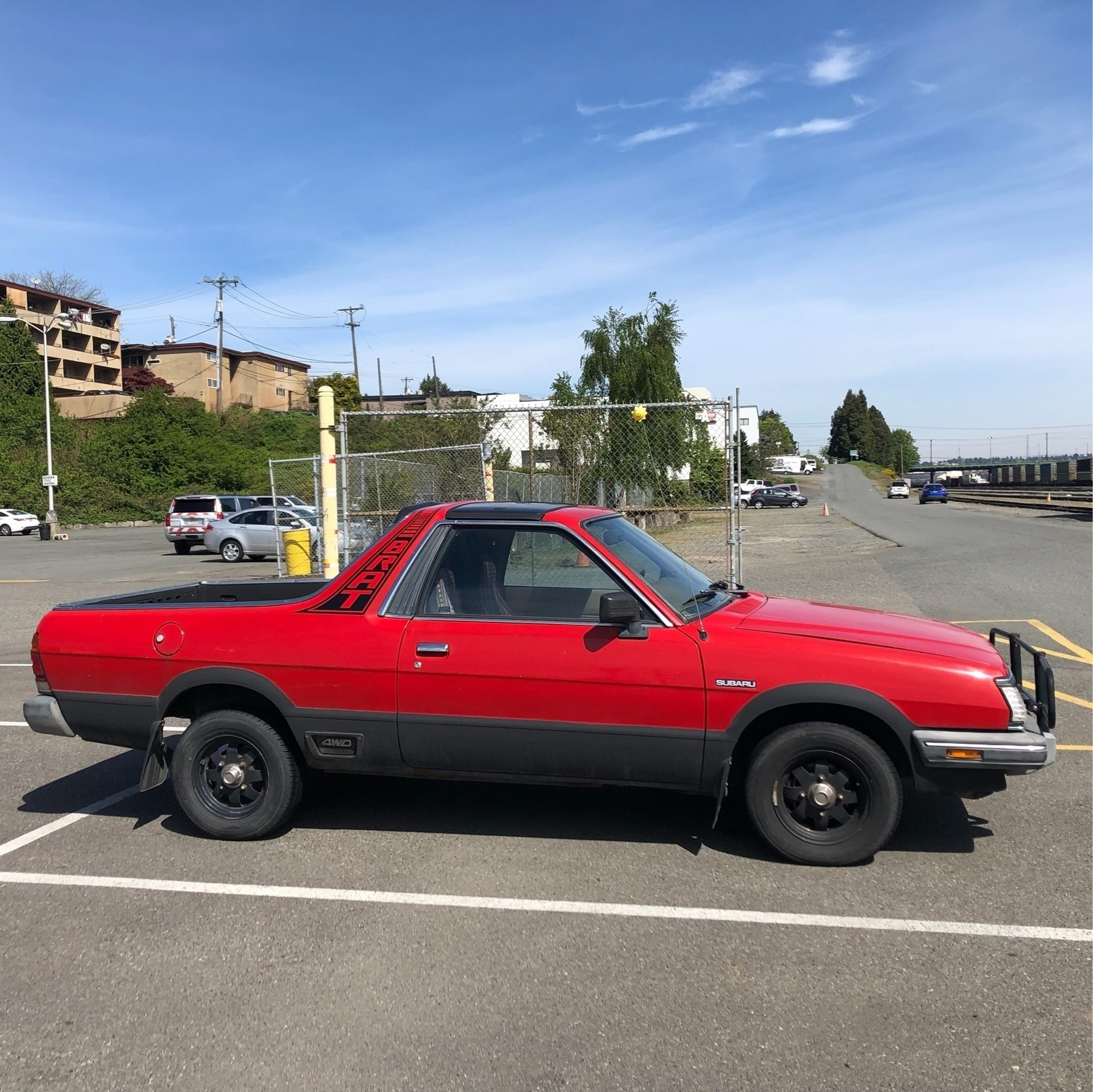A red Subaru Brat. (A car with a pick up truck rear end)