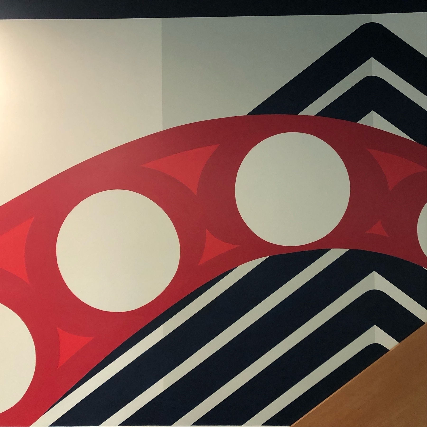 A wall mural showing an modern rendition of a red tentacle