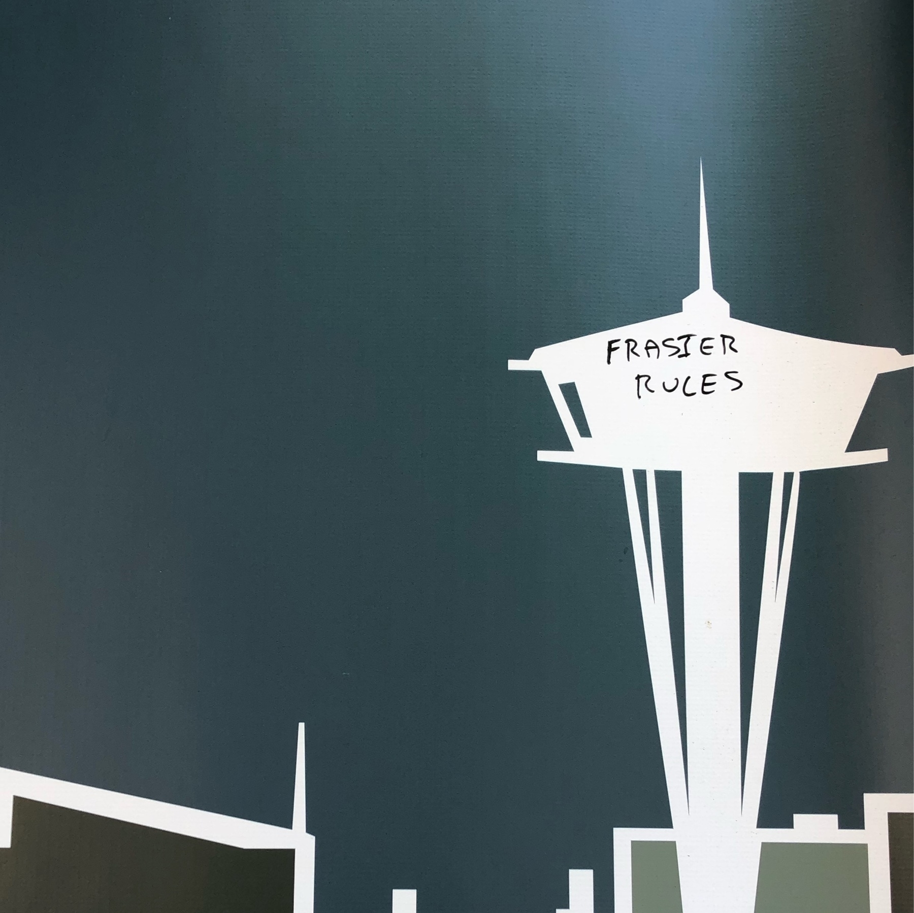 """A banner with the space needle is scrawled with the phrase """"Frasier Rules"""""""