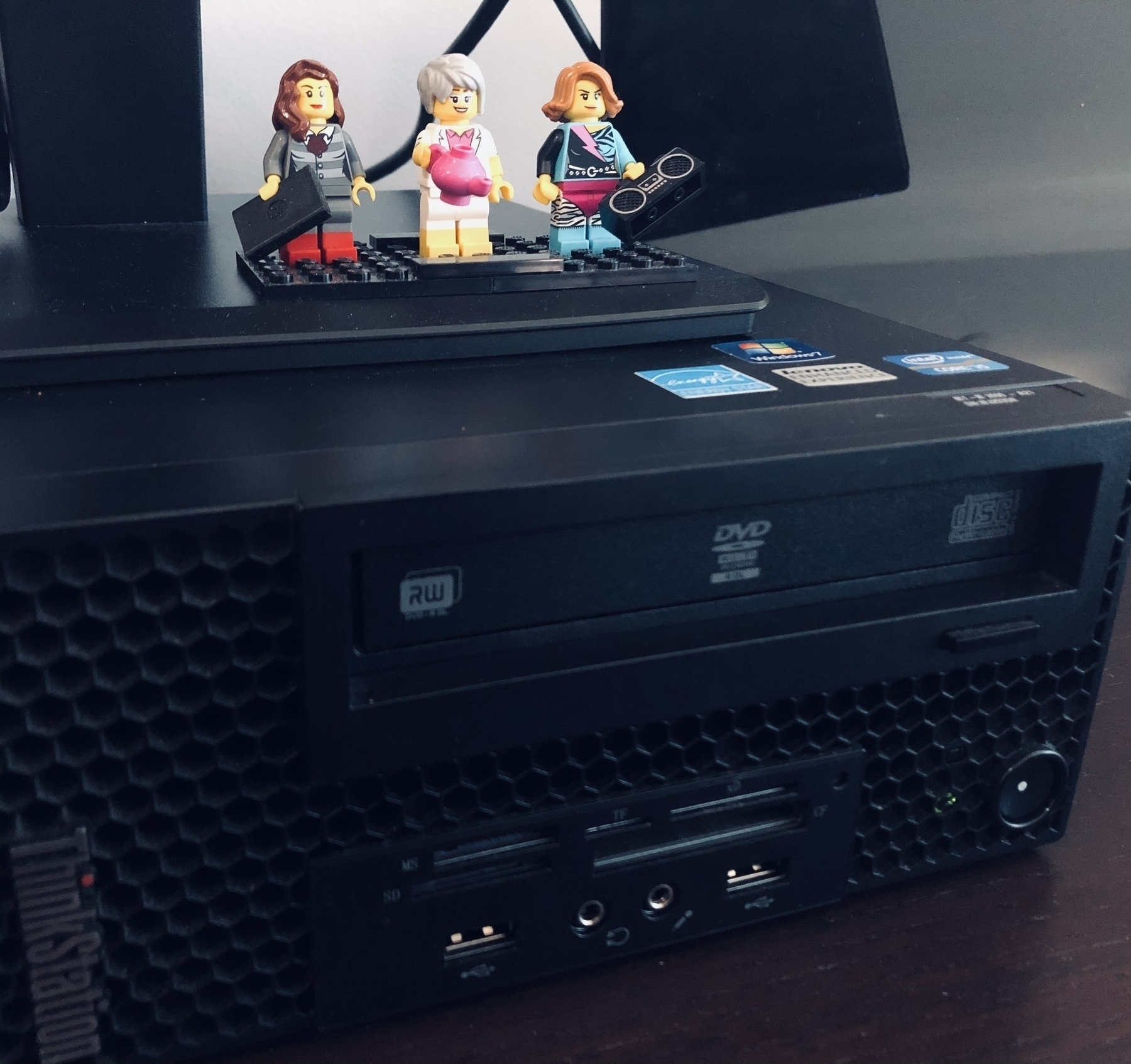 A closeup of Cheri's desktop PC with lego minifigs on top