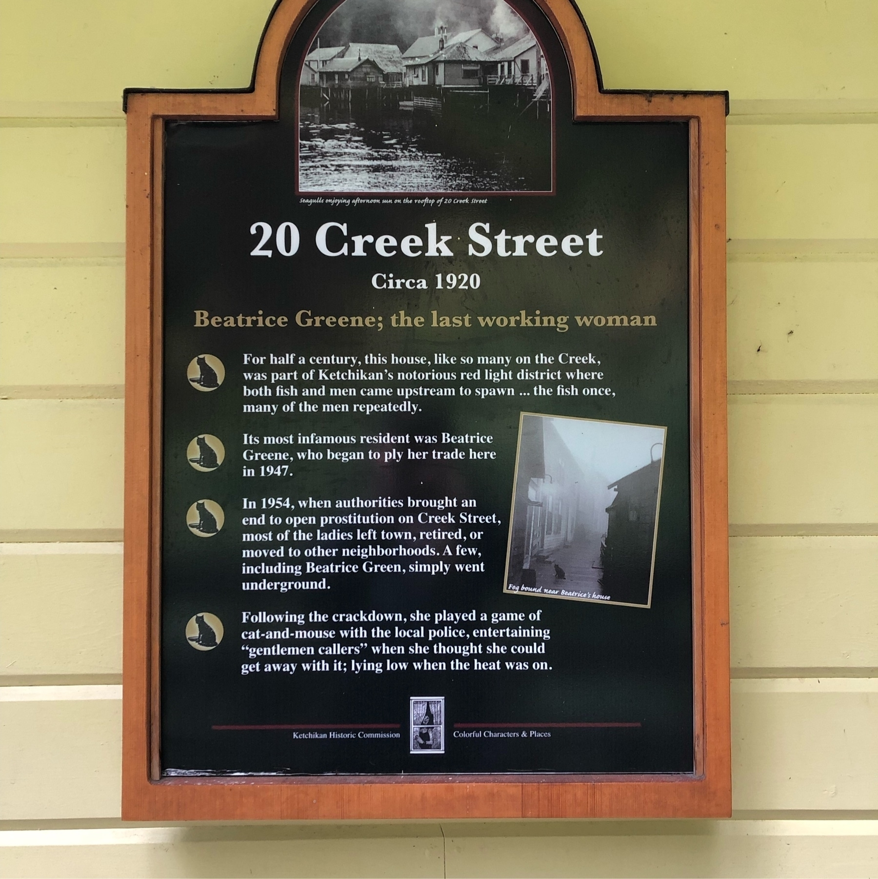 An informational sign tells the story of Beatrice Greene, the last working woman of Ketchikan, Alaska. She was a sex worker in the 1920s who dodged the cops to ply her trade in historic Ketichikan.