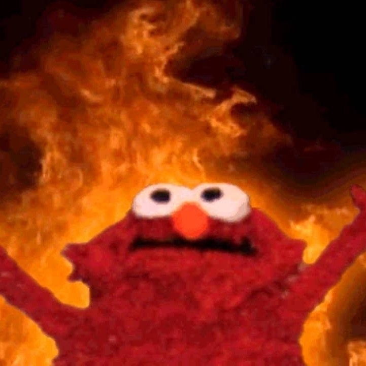 Elmo Meme. Elmo raises his arms in victory above the flames!