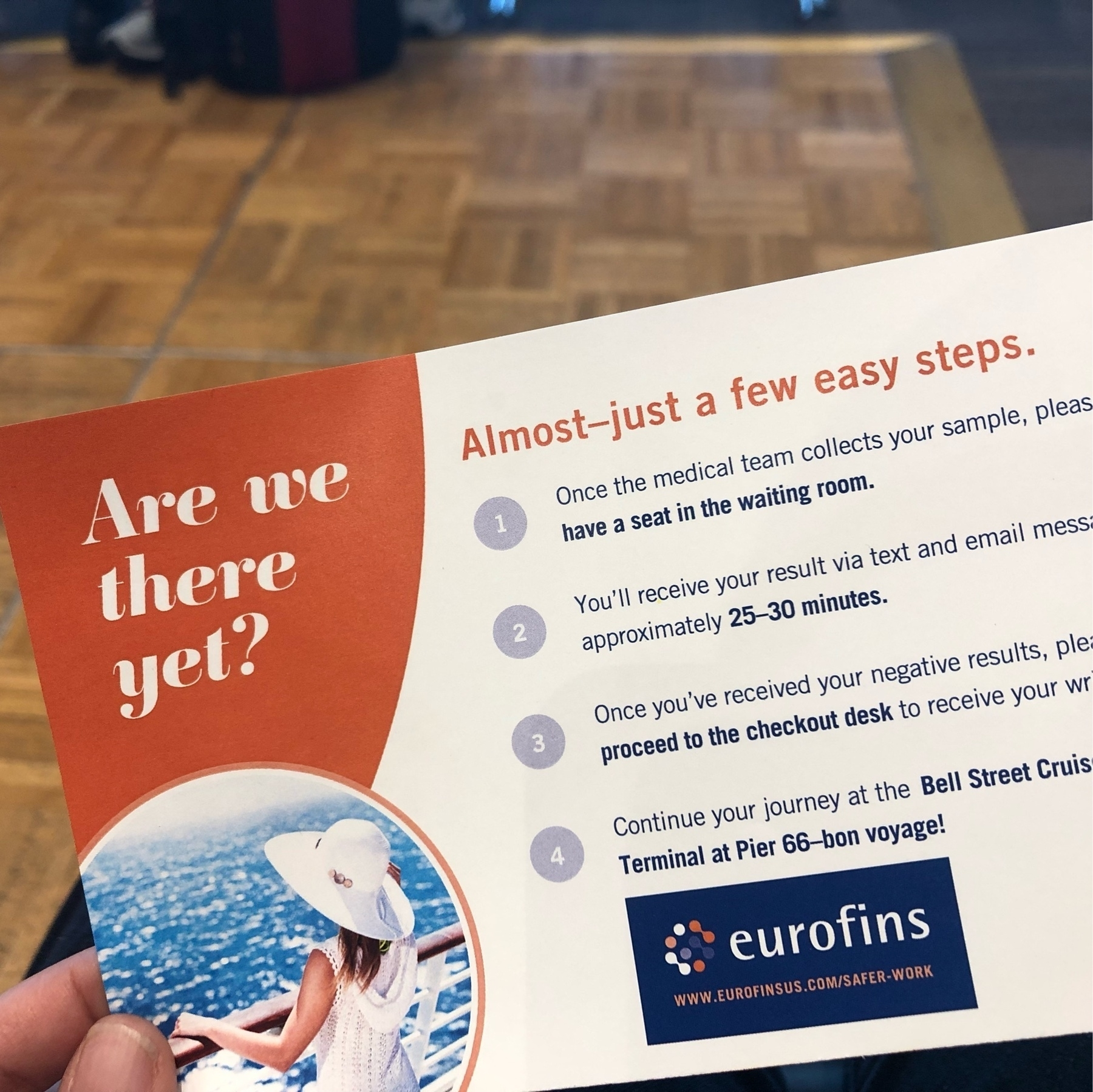 An instruction card for portside covid testing. It says: Are we there yet? Almost!