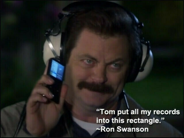 Ron Swanson holds up his Zune.
