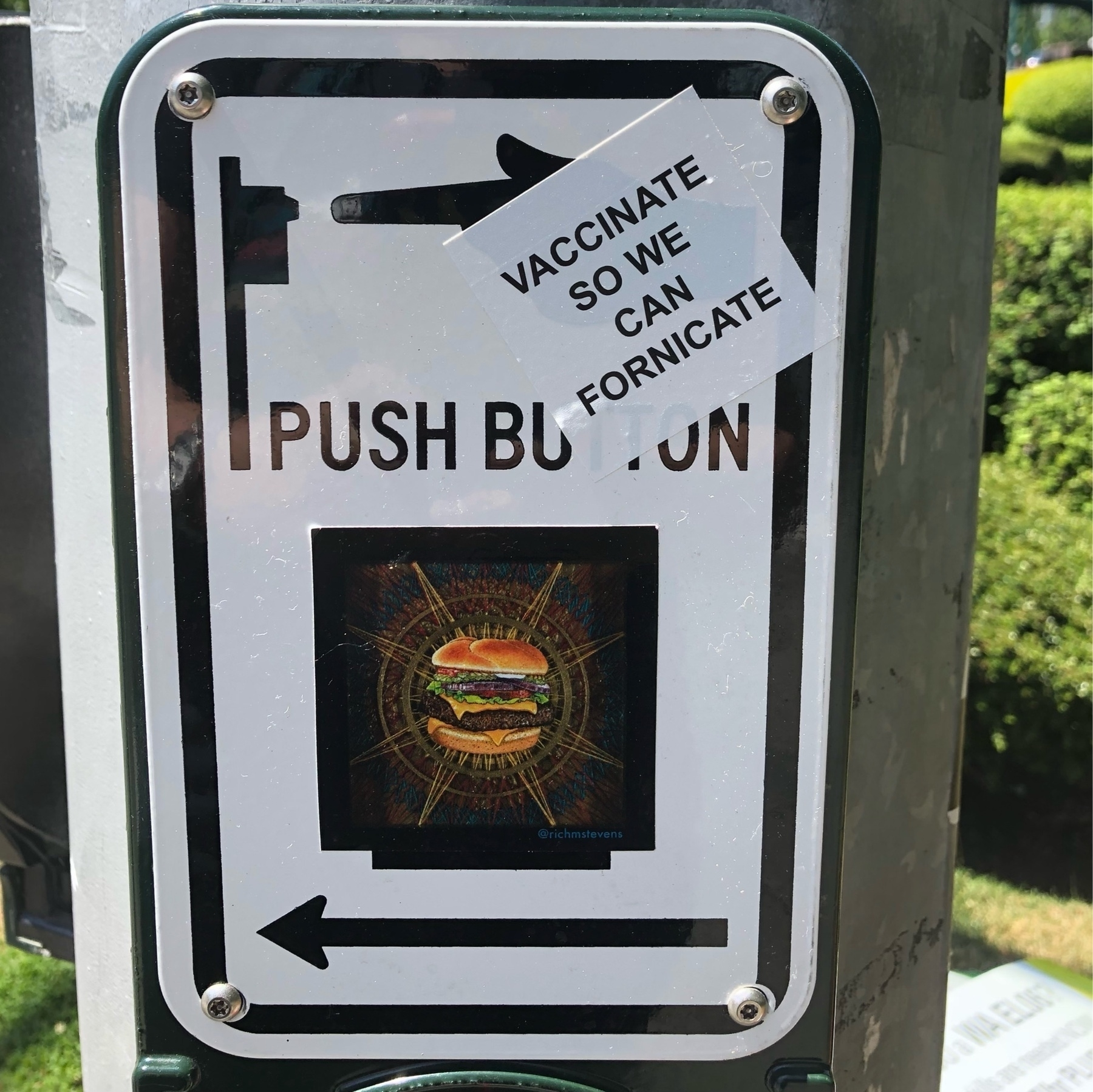 A crosswalk button in Seattle has a sticker on it that says: vaccinate so we can fornicate